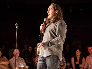 Ross Noble on stage at The Glee