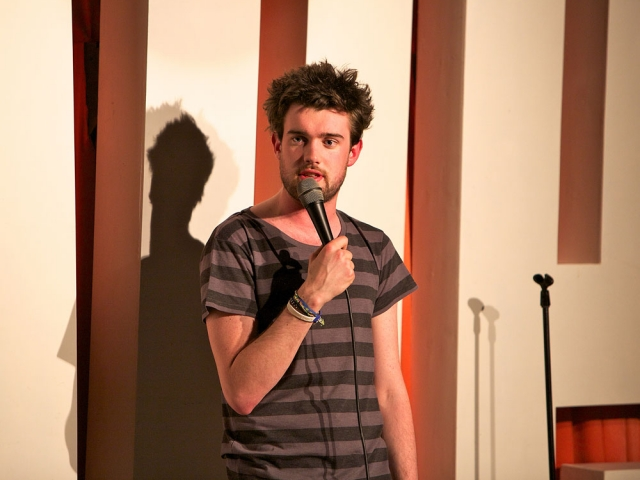 Jack Whitehall on stage at The Glee