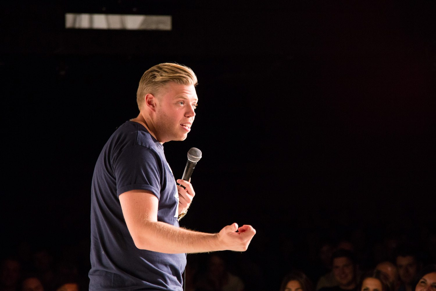 Rob Beckett on stage at The Glee