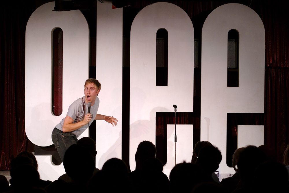 Russell Howard on stage at The Glee