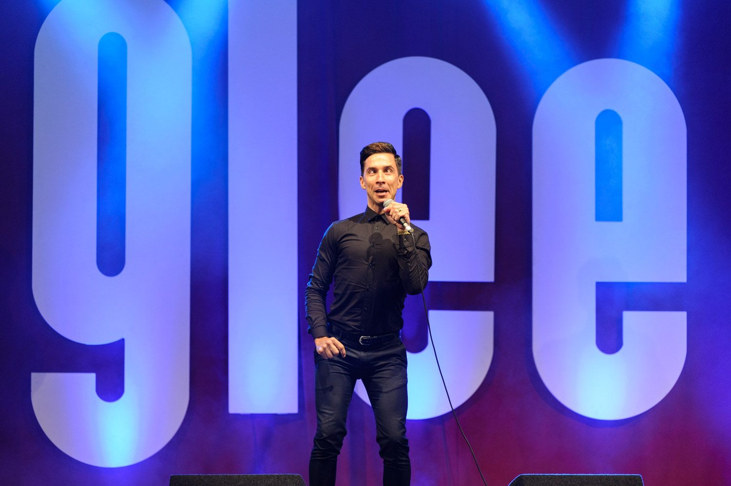 Russell Kane on stage at The Glee