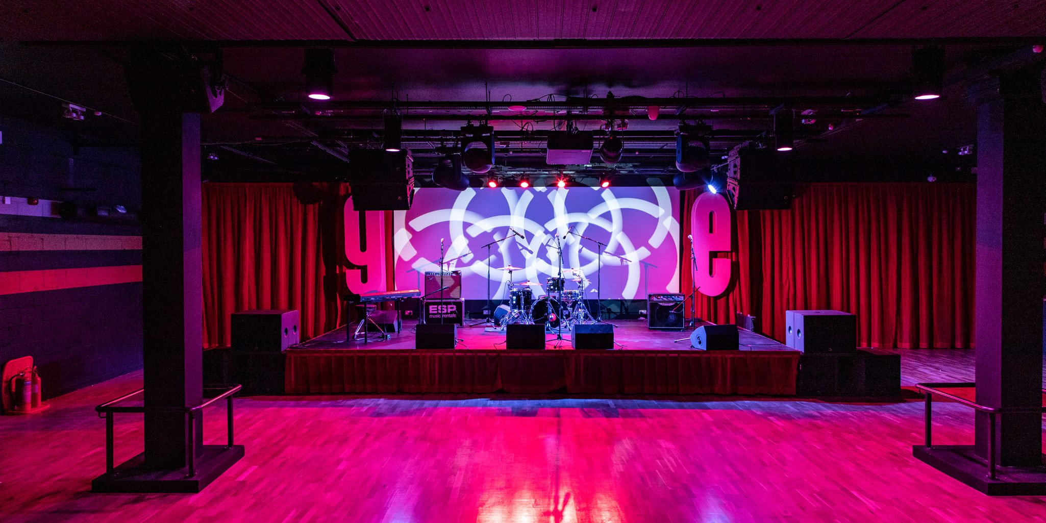 phot of venue with full band on stage